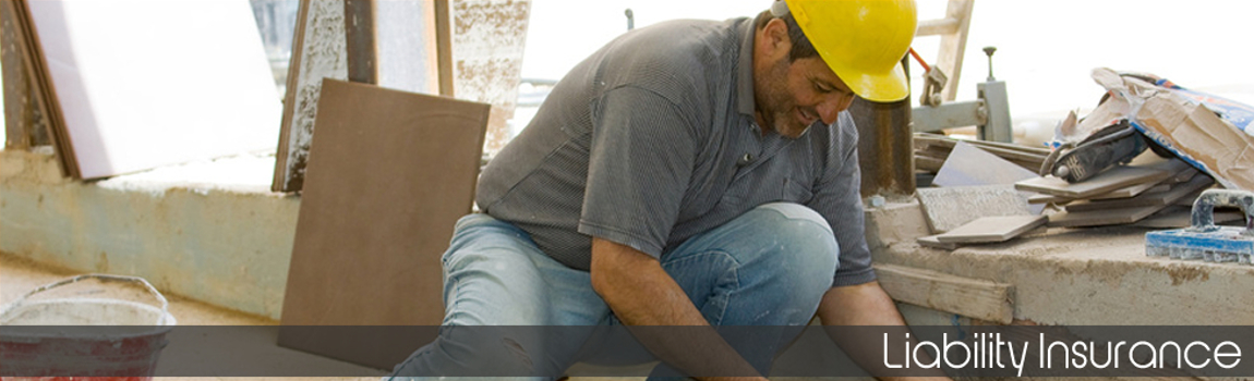 Liability Insurance - Builder laying tiles on a building site